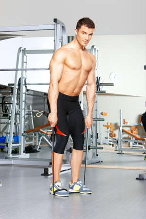 Handsome man at the gym doing exercises Stock Photo - 9796032