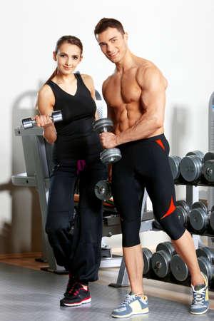 Deportivo par ejercer en el gimnasio de fitness Foto de archivo - 9796039