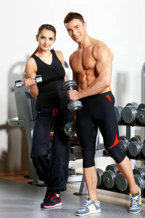 sporty: Sporty couple exercising at the fitness gym Stock Photo