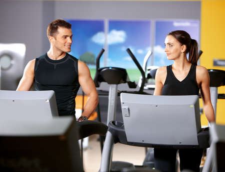 Sporty couple exercising at the fitness gym Stock Photo - 9795981