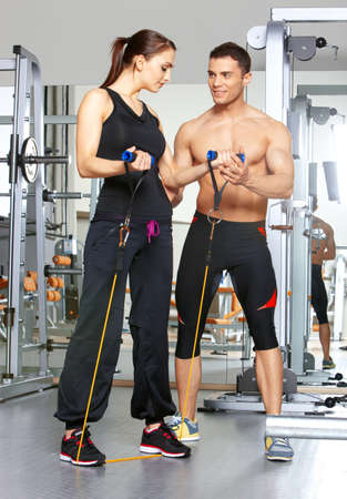 Sporty couple exercising at the fitness gym Stock Photo - 9796053
