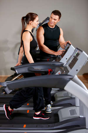 Sporty couple exercising at the fitness gym Stock Photo - 9796026