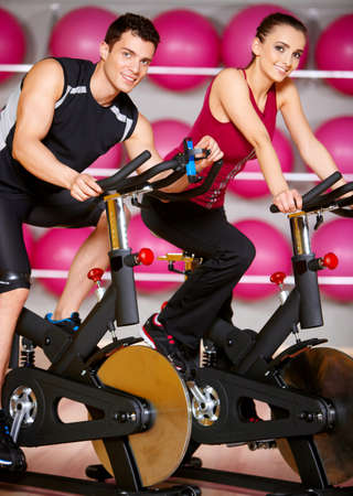 Sporty couple exercising at the fitness gym Stock Photo - 9796059