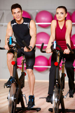 Sporty couple exercising at the fitness gym Banco de Imagens