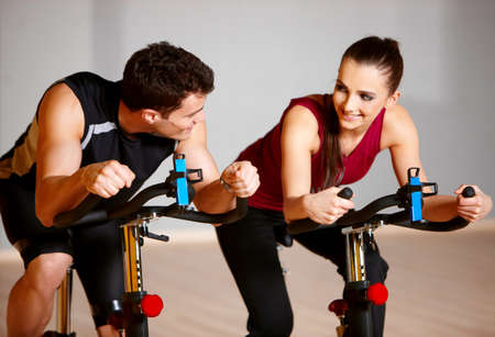 Sporty couple exercising at the fitness gym Stock Photo - 9796009