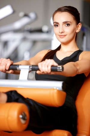 gym girl: Beautiful woman exercising at the fitness gym Stock Photo