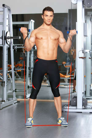 Handsome man at the gym doing exercises Stock Photo - 9796061