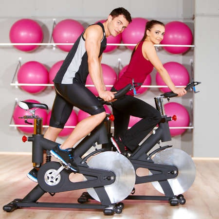cardio: Sporty couple exercising at the fitness gym Stock Photo