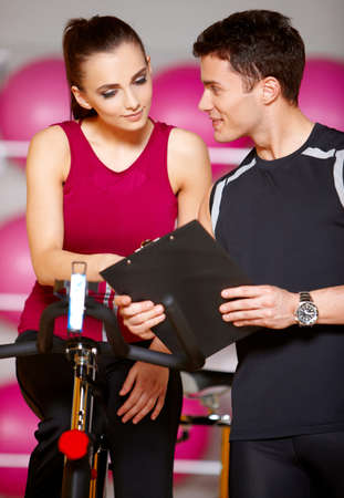 gym girl: Sporty couple exercising at the fitness gym Stock Photo