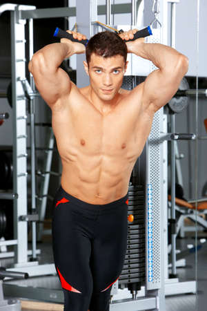 Handsome man at the gym doing exercises Stock Photo - 9796048