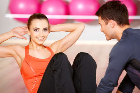 Sporty couple exercising at the fitness gym Stock Photo - 9796015