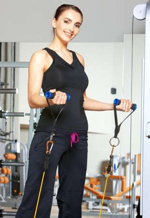 Beautiful woman exercising at the fitness gym Stock Photo - 9796035