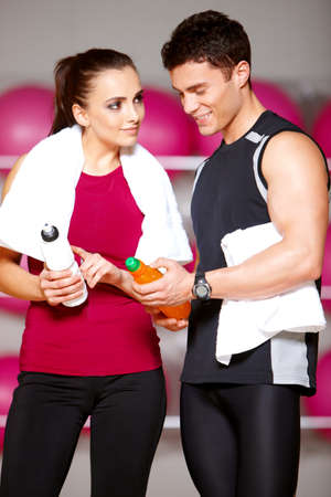 Sporty couple exercising at the fitness gym Stock Photo - 9796018