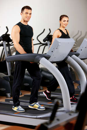 Sporty couple exercising at the fitness gym Stock Photo - 9795996