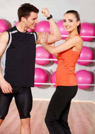 Sporty couple exercising at the fitness gym Stock Photo - 9796024
