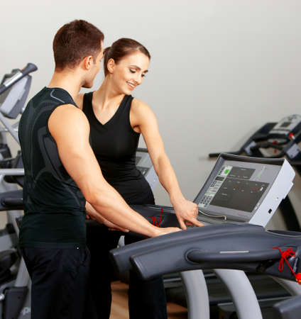 Sporty couple exercising at the fitness gym Stock Photo - 9795976