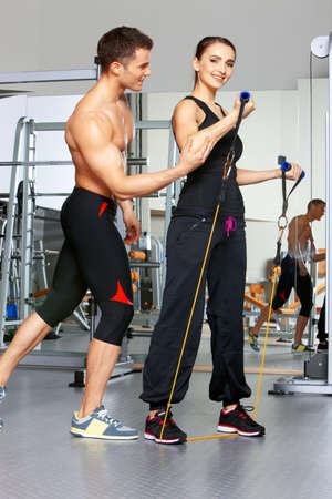 Sporty couple exercising at the fitness gym Stock Photo - 9796060