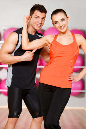 Sporty couple exercising at the fitness gym Stock Photo - 9796006