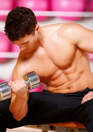 Handsome man at the gym doing exercises Stock Photo - 9796012