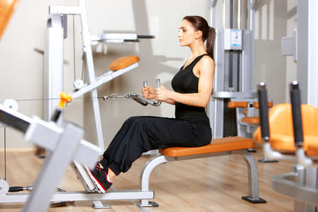 Beautiful woman exercising at the fitness gym Banco de Imagens