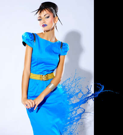 Beautiful female fashion model with paint splash photo