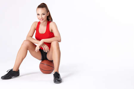 girl in shorts: Woman with basket ball