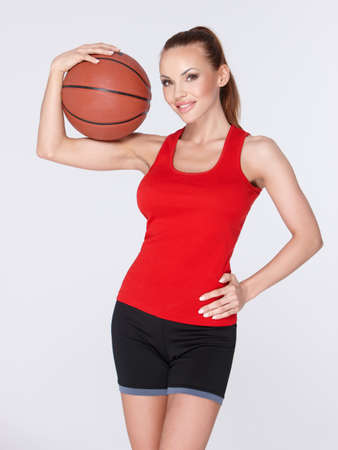 Woman with basket ball photo