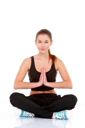 Portrait of pretty young woman doing yoga on white Stock Photo - 11419045
