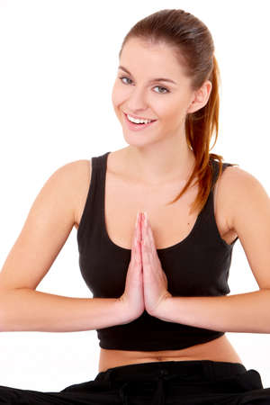 Portrait of pretty young woman doing yoga on white photo