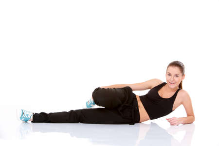 Beautiful fitness woman doing stretching exercise on white Stock Photo - 11419005
