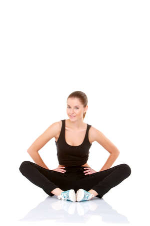 Beautiful fitness woman doing stretching exercise on white Stock Photo - 11419000