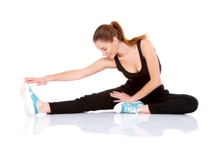 Beautiful fitness woman doing stretching exercise on white Stock Photo - 11419032