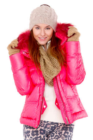 Cute young woman wearing winter jacket scarf and cap photo
