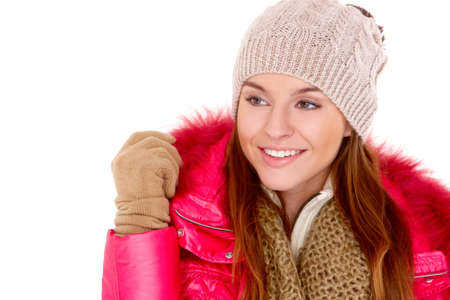 Pretty young woman wearing winter jacket scarf and cap