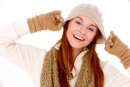 Young woman wearing warm winter clothes on white