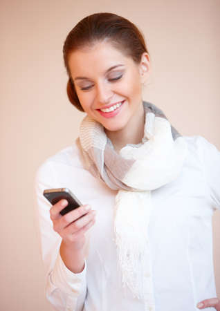 Portrait of young sexy brunette woman using mobile phone photo