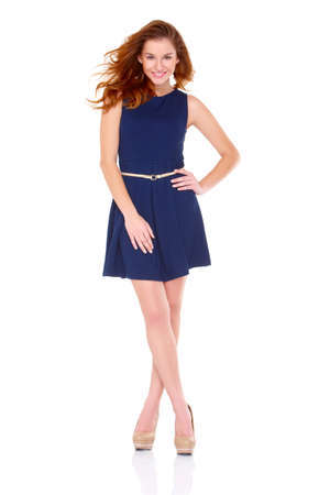 casual dress: Cute young woman in navy blue dress on white background Stock Photo