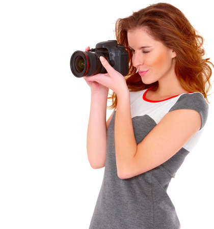 sexy pictures: Cute young woman in gray dress with digital camera on white Stock Photo