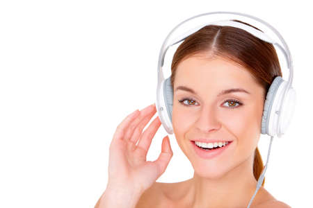 Portrait of beautiful young woman with headphones isolated on white Stock Photo - 11419043