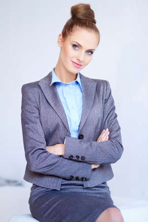 Portrait of a beautiful young business woman on white Stock Photo - 11986846