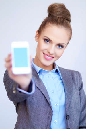 sexy office girl: Business woman is showing smart phone Stock Photo