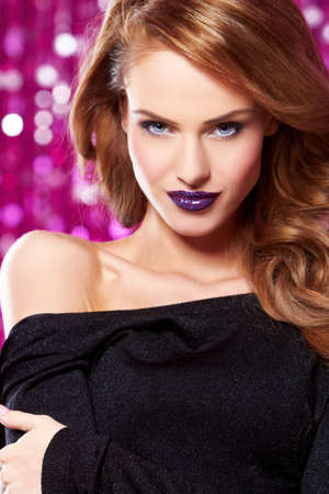Portrait of beautiful sexy woman on purple background