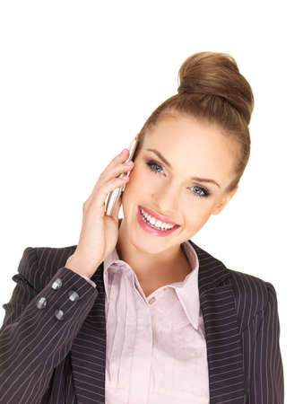Pretty female businesswoman talking mobile phone photo