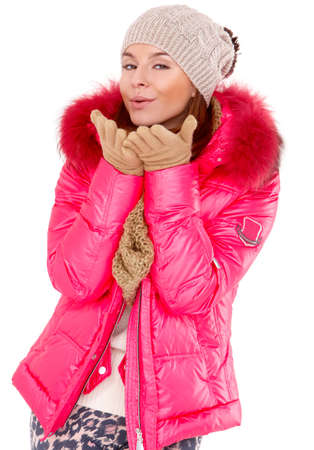 Pretty young woman wearing winter jacket scarf and cap photo