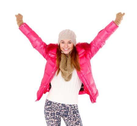 Beautiful young woman wearing winter jacket scarf and cap photo