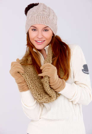 Young cute woman wearing warm clothes on white photo