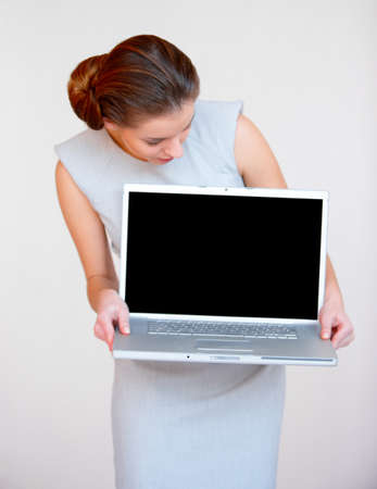 Portrait of a young attractive business woman with laptop computer photo