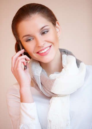 Portrait of young sexy brunette woman talking mobile phone photo