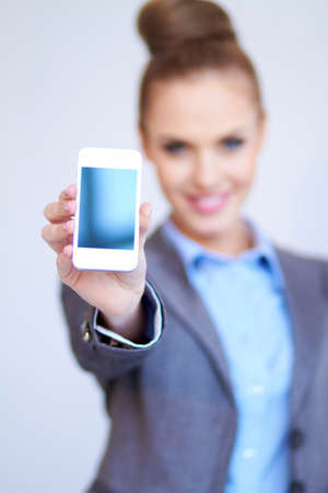 Business woman is showing smart phone photo