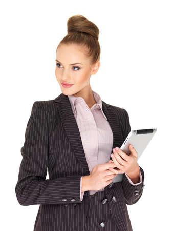 businesswoman suit: Joven mujer de negocios trabajando en tabletas Foto de archivo